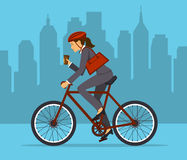 Cool Businesswoman riding bicycle to office. Royalty Free Stock Photo