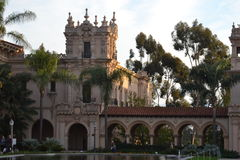 Cool castle looking building. Shot of a castle type building at park in sandiego with the trees popping up from behind and a few palms in the front as well as a Stock Photography