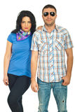Cool casual couple. Fashionable casual couple posing  isolated on white background Stock Photo