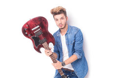 Cool casual man holding an electric guitar Stock Photography