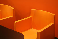 Cool chair. S and table on orange colors Stock Image