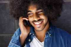 Cool cheerful guy using cell phone Stock Photos