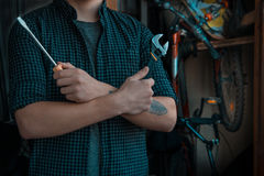 Cool classy young dude with a tattoo preparing to fix his bicycl Royalty Free Stock Photos