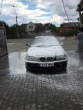 Bmw car wash black stock images