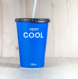 Cool coffee cup on wood dick Stock Photos