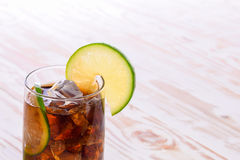 Cool Cola Drink With Lemon and Ice cube on wooden table. Royalty Free Stock Image