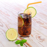 Cool Cola Drink With Lemon and Ice cube on wooden table. Royalty Free Stock Photography
