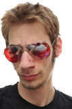 Cool and collected. A portrait of a young man with red aviator sunglasses Stock Images