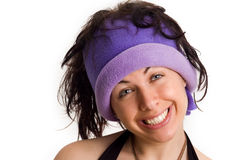 Cool college girl with a funny smile. A college girl with a cool hat smiling in a funny way Royalty Free Stock Images