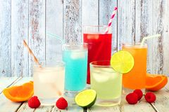 Cool colorful summer drinks against rustic wood Royalty Free Stock Images