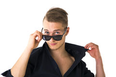 Cool confident blond young man with sunglasses Stock Photography
