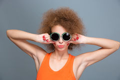 Cool confident young female posing and making grimace Royalty Free Stock Photo