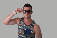 Cool confident young man with sunglasses and tank-top Stock Photo