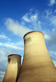 Cool Cooling Towers. Cooling Towers at an electricity generating station photographed in late evening sunlight Stock Photo