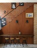 Cool corner in coffee cafeteria. With vintage brick wall and wooden interior design Stock Photos