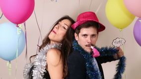 Cool couple dancing with props. Cool young couple dancing with props in photo booth stock footage