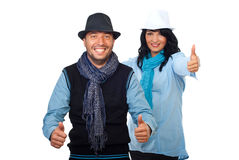 Cool couple giving thumbs. Cool happy couple giving thumbs up and smiling isolated on white background,check also Business people Royalty Free Stock Photography