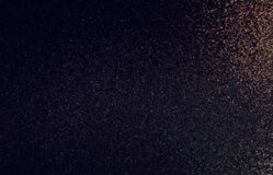 Dark brown shimmer background. Dusty texture abstract. stock image