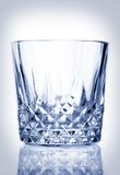 Cool crystal glass tumbler. With counter reflection Royalty Free Stock Photos