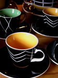 Cool Cups. Modern coffee cups and saucers Stock Photography