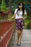 Cool and cute girl. A girl that looks cool and cute was standing in the middle of the bridge Royalty Free Stock Image