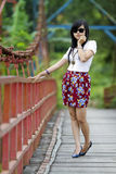 Cool and cute girl. A girl that looks cool and cute was standing in the middle of the bridge Stock Images