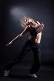 Cool dancer. Cool modern woman dancer vs black Royalty Free Stock Photography