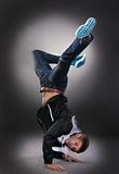 Cool dancer man. On gray background Royalty Free Stock Photography