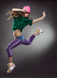 Cool dancer woman. On gray background Royalty Free Stock Photo