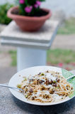 Cool and delicious pasta with lemon, arugula and pine nuts. Italy royalty free stock photography
