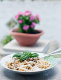 Cool and delicious pasta with lemon, arugula and pine nuts. Italy royalty free stock photos