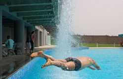 Cool dive. A man dives into a pool Royalty Free Stock Photo