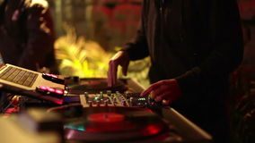 Cool DJ in bar. Cool dj behind the turntables performing in a bar stock video footage