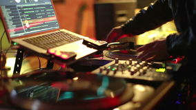 Cool DJ in bar. Cool dj behind the turntables performing in a bar stock footage