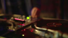 Cool DJ in bar. Cool dj behind the turntables performing in a bar stock video