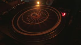 Cool dj behind the turntables performing in a bar. 4k stock footage