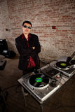 Cool DJ pose Royalty Free Stock Image