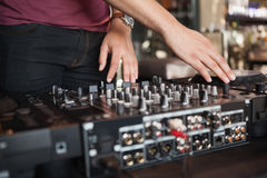 Cool dj spinning the decks Royalty Free Stock Images