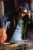 Cool dj spinning the decks Royalty Free Stock Image