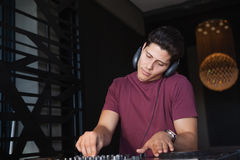 Cool dj working on a sound mixing desk Royalty Free Stock Image