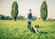 Cool dog playing with his owner Royalty Free Stock Image