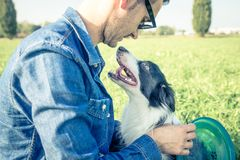 Cool dog playing with his owner Stock Photography