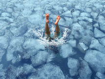 Cool Down. And Cooling off concept as a diver diving into frozen ice water as a symbol for managing hot weather summer heat and refreshing break from a heatwave Royalty Free Stock Photography