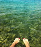 Cool down in the sea. Legs cooling down in the sea Stock Photography