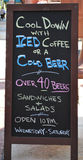 Cool down sign. Restaurant menu board enticing customers to come in cool down with iced coffee or a cool beer royalty free stock images