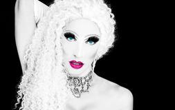 Glamorous drag queen. Cool drag queen with spectacular makeup, glamorous stylish look, posing with   proud and  style for lgtb equality gay rights  with rainbow Royalty Free Stock Photo