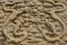 Cool dragon sculpture. Ancient  dragon sculpture pattern  with marble rock Stock Image