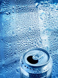 Cool drink concept. Cool aluminium tin drink can opened on blue drops background Royalty Free Stock Image