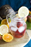 Cool drink with strawberry in jar. Cool drink with strawberry and lemon in glass jar Stock Images
