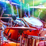 Cool drums on the stage. Musical instruments, equipment for professional musicians, night performance of rock and roll band Stock Photography